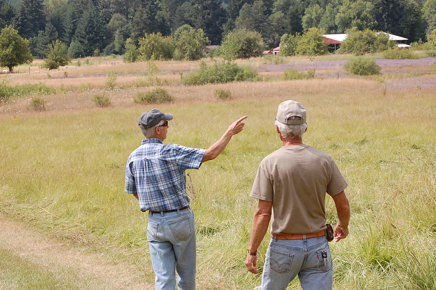 Cliff Hall shows fellow board member Jerry Paul some of the sites at Luckiamute Meadows Farm.