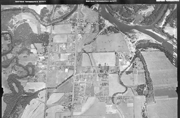 In this aerial view from 1940, both the dam on the Marys River at the inlet of the Mill Race and the straight channel that empties into the Willamette are visible. Image courtesy of the City of Corvallis.