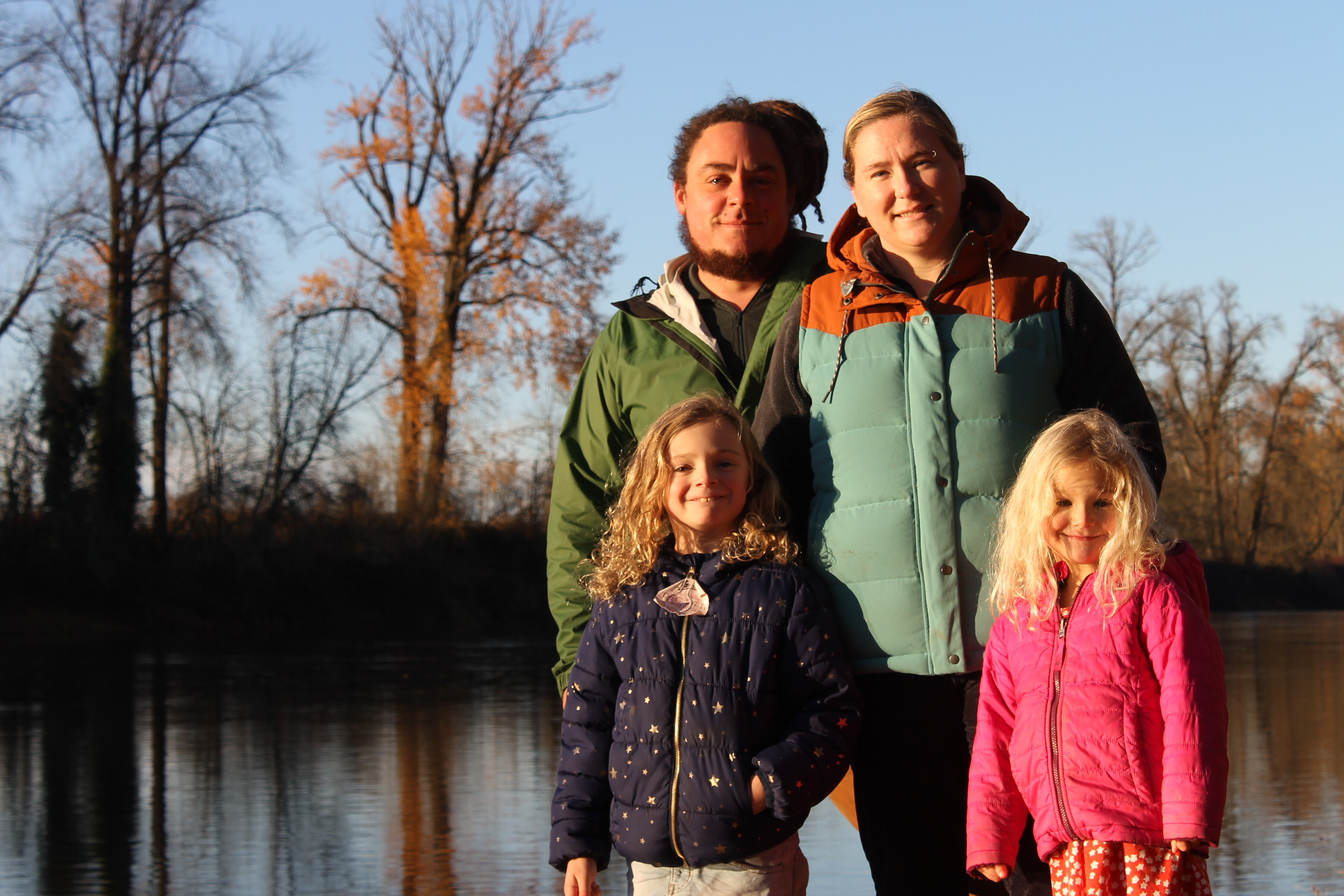 The Mellenthin family (Matt, Serene, and 2 daughters) at home along the river's edge.