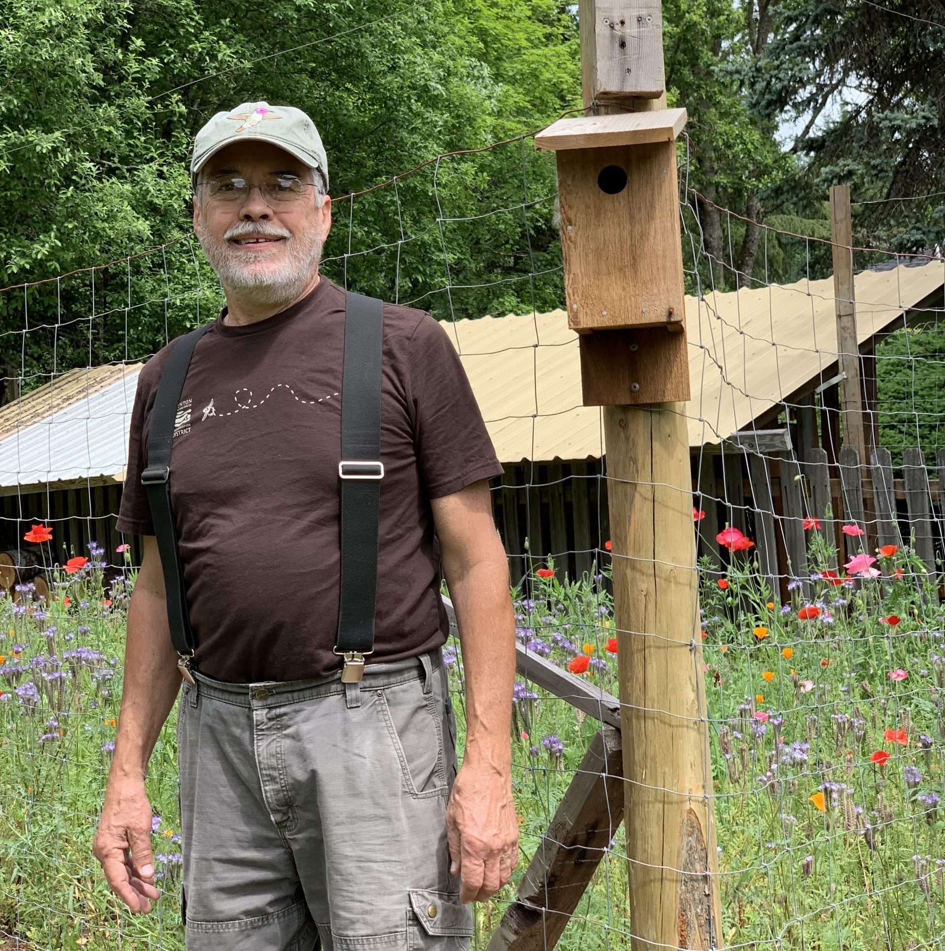 Nick with bird box and wildflower planting