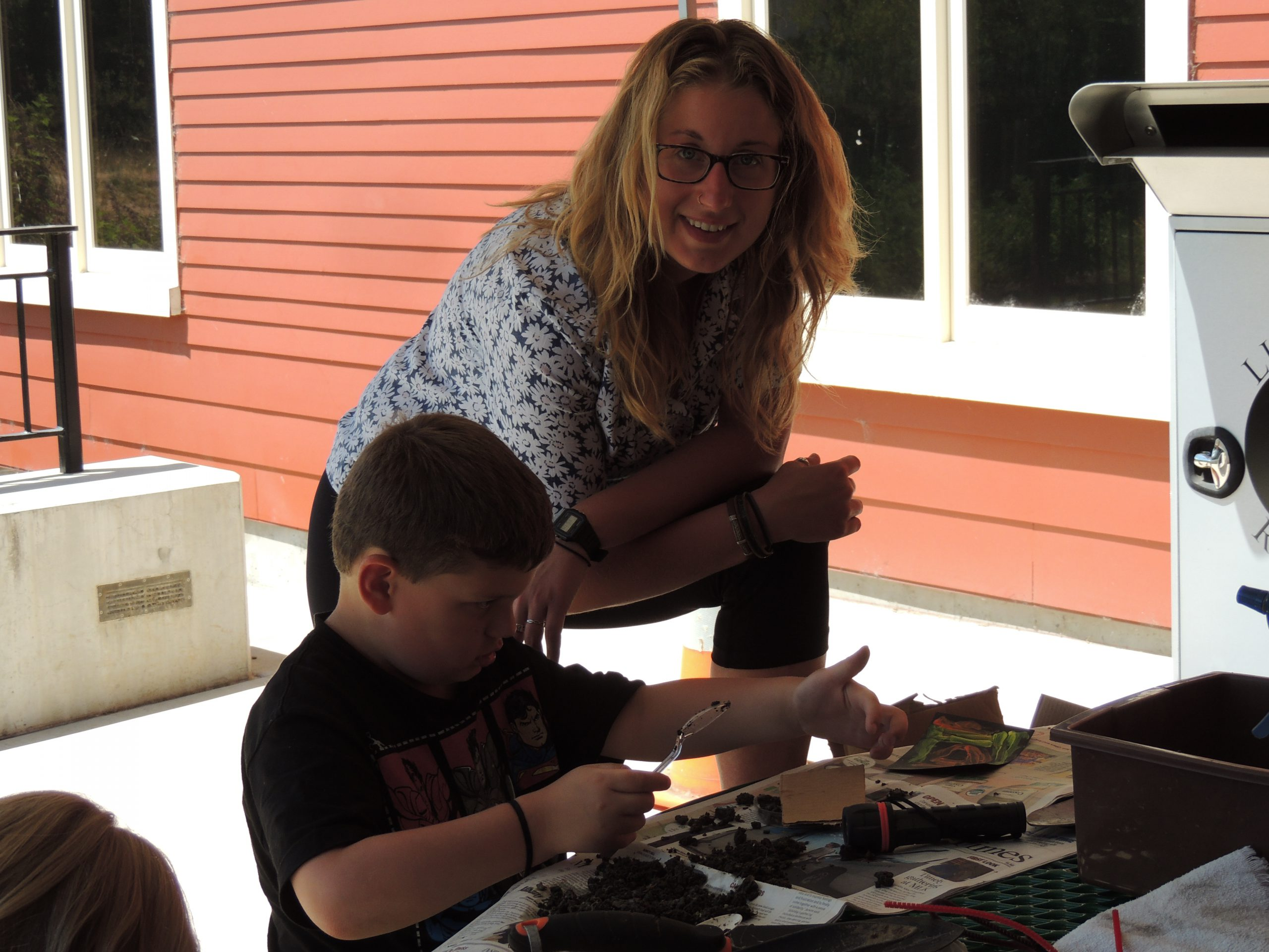 Amanda Pennino shares her love for soil creatures durig Heros for the Planet at Monroe Library
