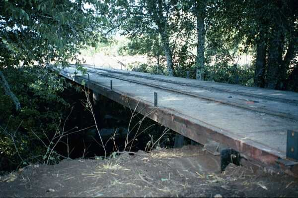 A recycled 89' railroad flatcar was installed over Maxfield Creek for access to the southern pasture.