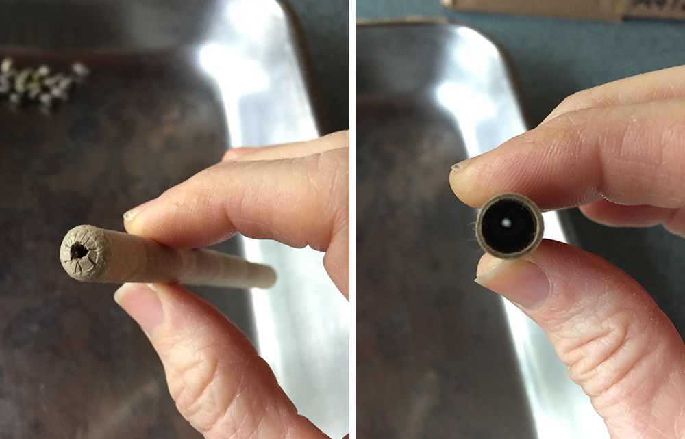 the closed and open ends of a paper tube