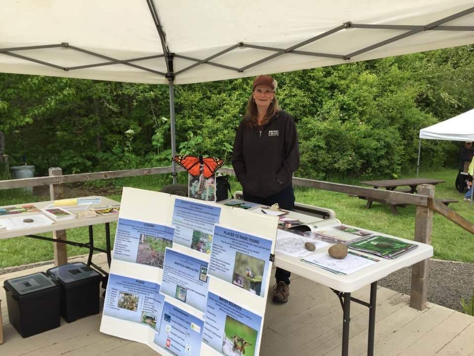 Molly shares information at a community event