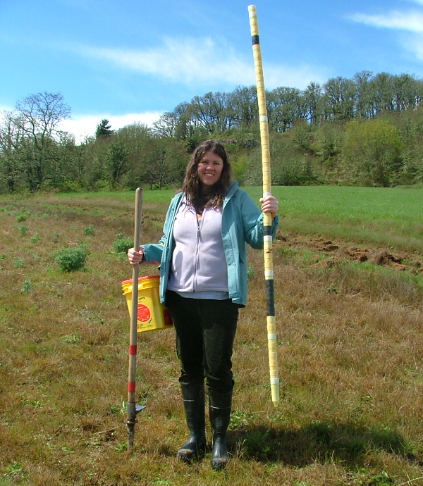 Heath standing in a field with soil testing equipment