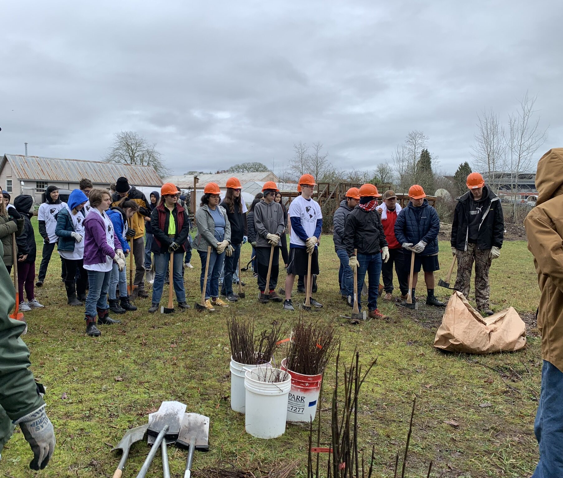 high school students preparing to plant natives