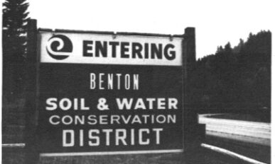 A large road sign that says Entering Benton Soil and Water Conservation District